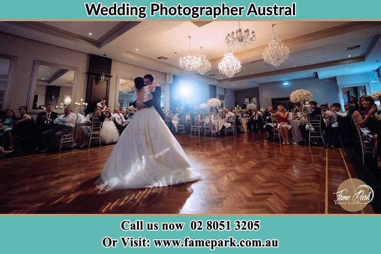 Photo of the Bride and the Groom hugging on the dance floor Austral NSW 2179