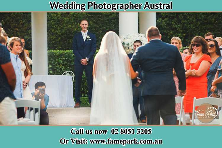 Photo of the Bride with her father walking the aisle Austral NSW 2179