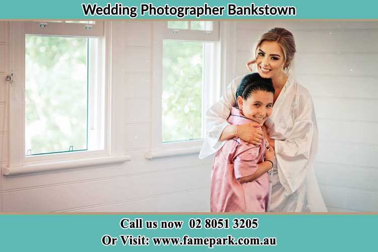 Photo of the Bride hugging the flower girl Bankstown NSW 2200