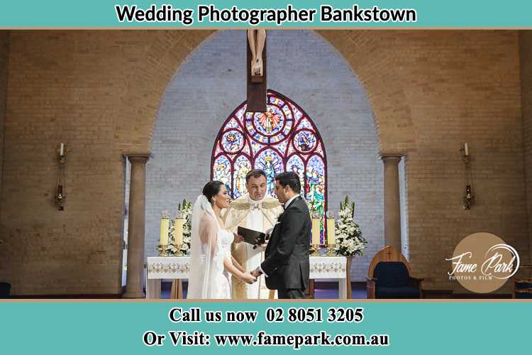 Photo of the Bride and Groom at the Altar with the Priest Bankstown NSW 2200