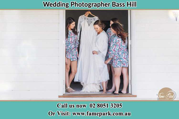 Photo of the Bride and the bridesmaids checking the wedding gown at the door Bass Hill NSW 2197