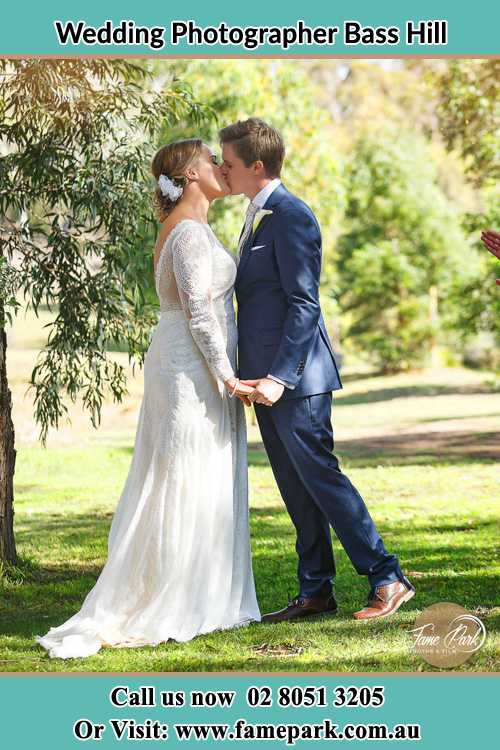 Photo of the Bride and the Groom kissing at the garden Bass Hill NSW 2197