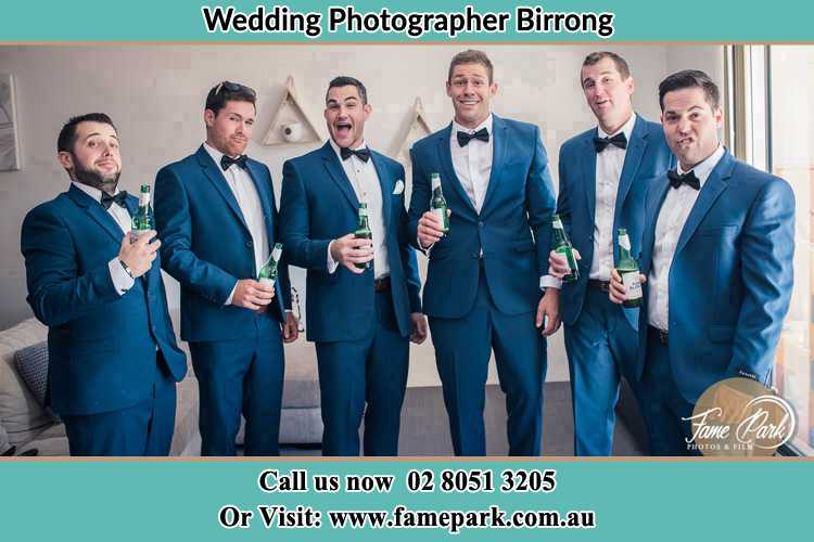 The groom and his groomsmen striking a wacky pose in front of the camera Birrong NSW 2143