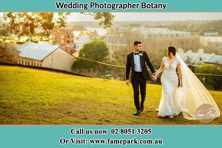 Photo of the Groom and the Bride walking at the yard Botany NSW 2019