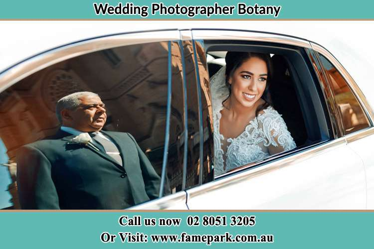 Photo of the Bride inside the bridal car with her father standing outside Botany NSW 2019