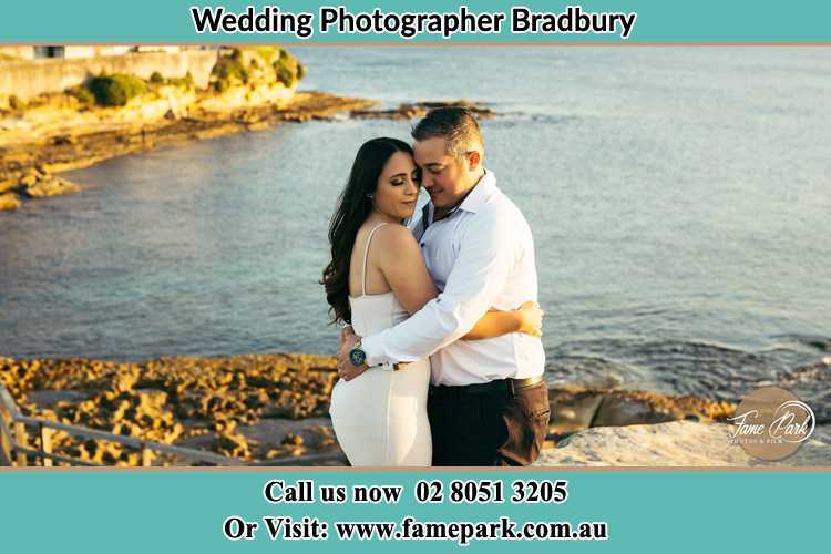 Photo of the Bride and the Groom hugging near the lake Bradbury NSW 2560