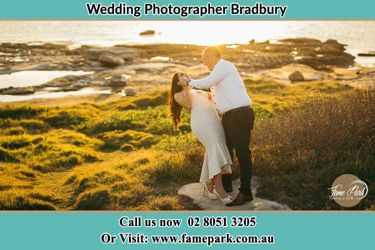 Photo of the Bride and the Groom dancing near the lake Bradbury NSW 2560