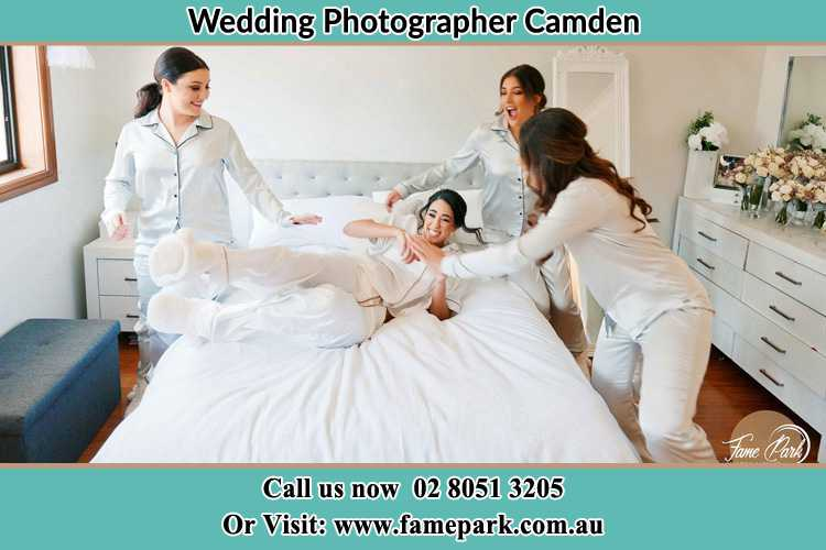 Photo of the Bride and the bridesmaids playing on bed Camden NSW 2570
