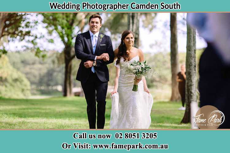 Photo of the Groom and the Bride walking Camden South NSW 2570