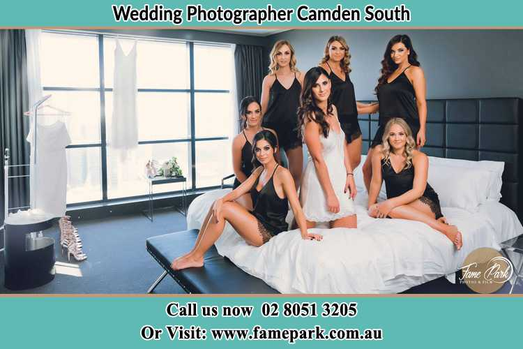 Photo of the Bride and the bridesmaids wearing lingerie on bed Camden South NSW 2570