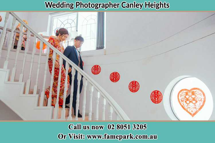 Photo of the Bride and the Groom going down the stair Canley Heights NSW 2166