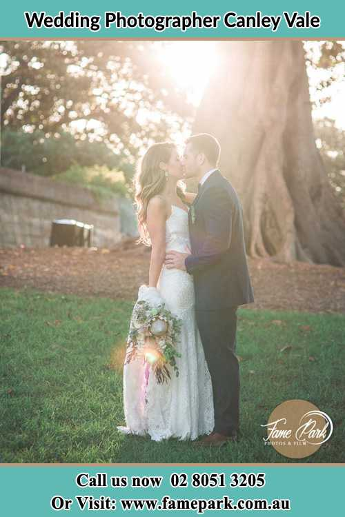 Photo of the Bride and the Groom kissing at the yard Canley Vale NSW 2166