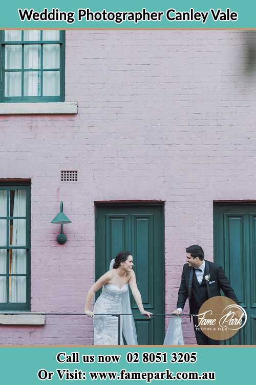 Photo of the Bride and the Groom looking each other at the balcony Canley Vale NSW 2166