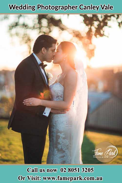 Photo of the Groom and the Bride kissing at the yard Canley Vale NSW 2166