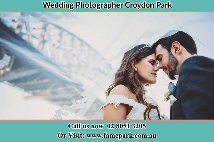 Close up photo of the Bride and the Groom under the bridge Croydon Park NSW 2133