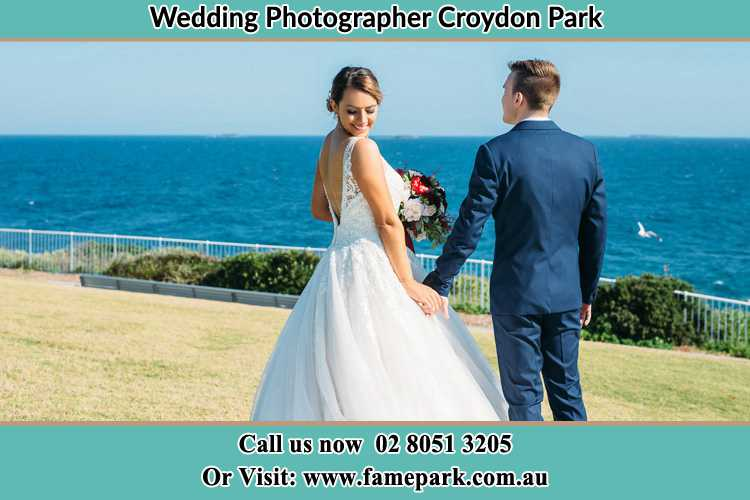 Photo of the Bride and the Groom holding hands at the yard Croydon Park NSW 2133