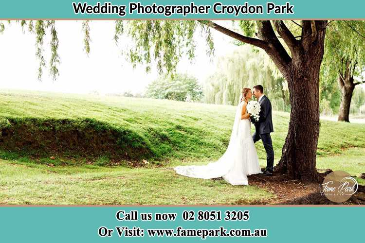 Photo of the Bride and the Groom kissing under the tree Croydon Park NSW 2133