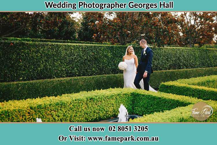 Photo of the Bride and the Groom walking at the garden Georges Hall NSW 2198