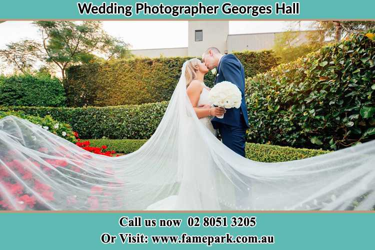 Photo of the Bride and the Groom kissing at the garden Georges Hall NSW 2198