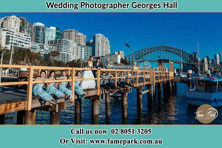 Photo of the Groom and the Bride with the entourage at the bridge Georges Hall NSW 2198