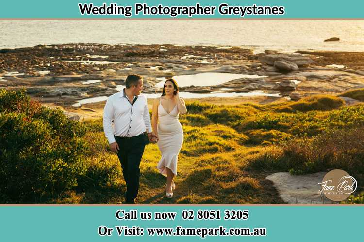 Photo of the Groom and the Bride walking near the lake Greystanes NSW 2145