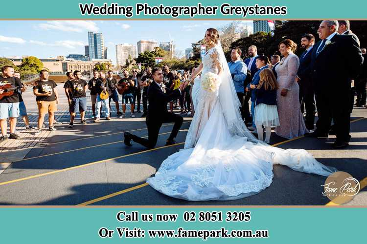 Groom Kneeling down in front of the Bride Greystanes NSW 2145