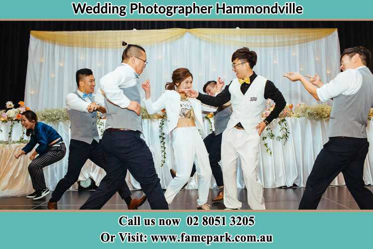Photo of the Groom and the Bride dancing with the groomsmen on the dance floor Hammondville NSW 2170