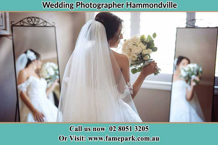 Photo of the Bride holding flower at the front of the mirrors Hammondville NSW 2170