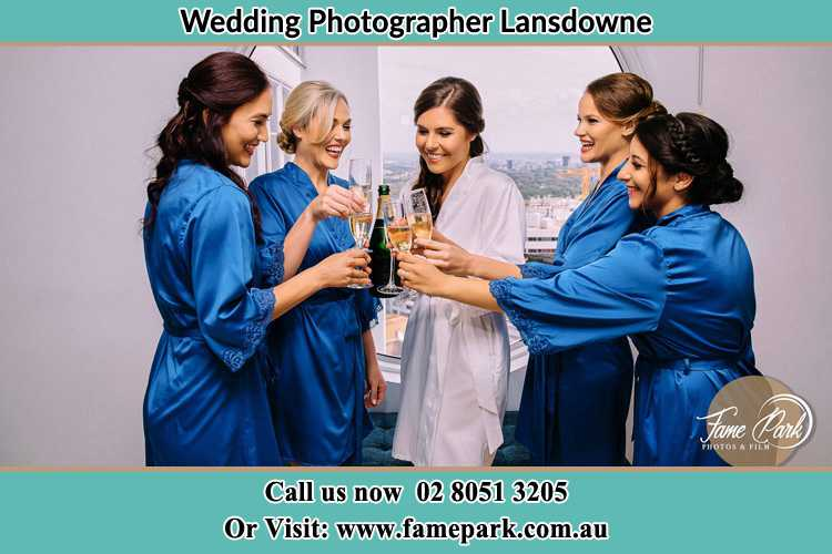 Photo of the Bride and the bridesmaids having wine Lansdowne NSW 2430