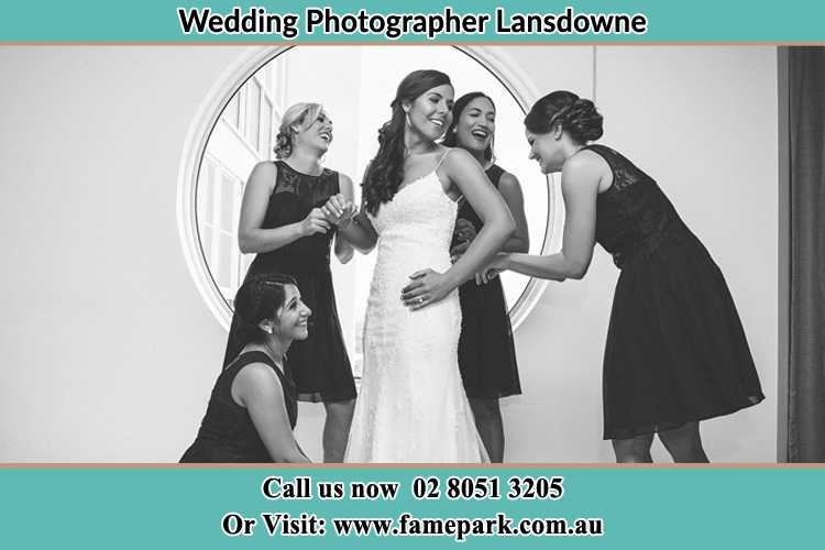 Photo of the Bride and the bridesmaids near the window Lansdowne NSW 2430