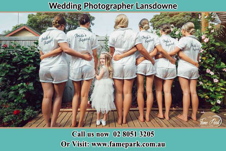 Behind photo of the Bride and the bridesmaids with the flower girl looking back Lansdowne NSW 2430