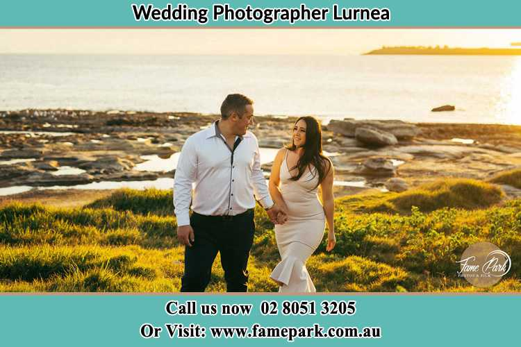 Photo of the Groom and the Bride walking near the lake Lurnea NSW 2170
