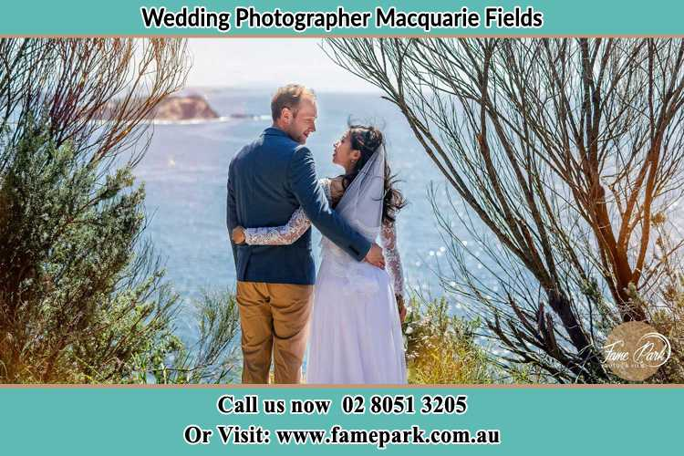 Photo of the Groom and the Bride looking each other near the sea front Macquarie Fields NSW 2564