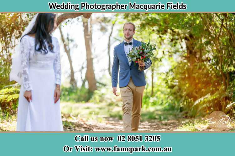 Photo of the Groom bringing flower to the Bride Macquarie Fields NSW 2564