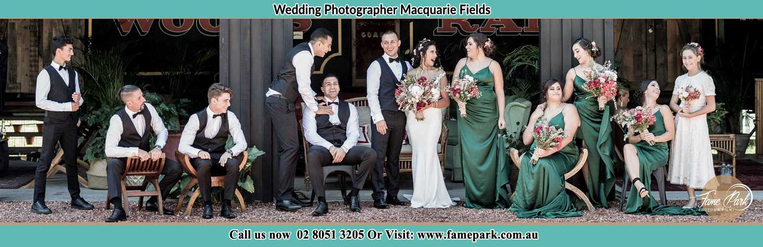 The Bride and the Groom with their entourage pose for the camera Macquarie Fields NSW 2564