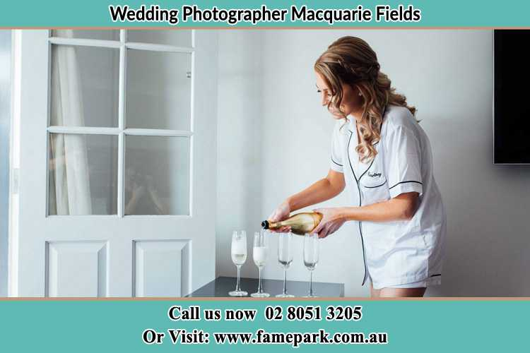 Photo of the Bride pouring wine to the glasses Macquarie Fields NSW 2564