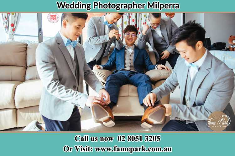 Photo of the Groom helping by the groomsmen getting ready Milperra NSW 2214