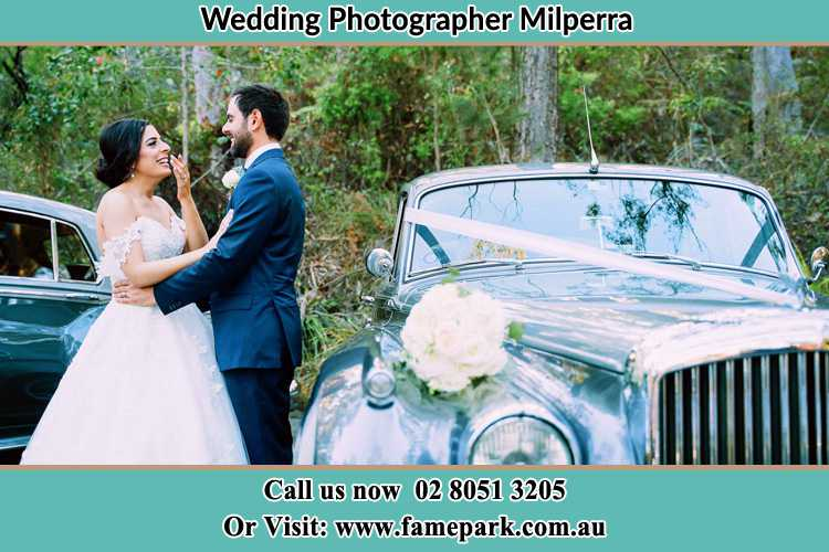 Photo of the Bride and the Groom near the bridal car Milperra NSW 2214