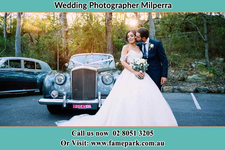 Photo of the Bride and the Groom at the front of the bridal car Milperra NSW 2214