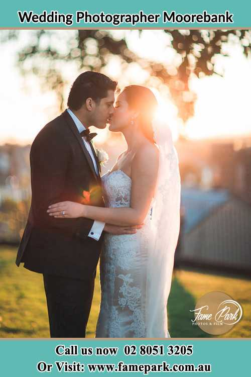 Photo of the Groom and the Bride kissing at the yard Moorebank NSW 2170