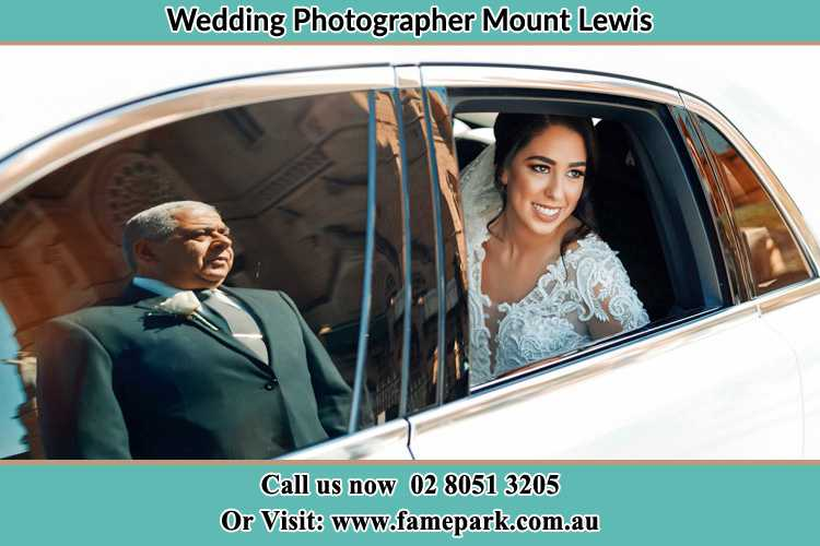 Photo of the Bride inside the bridal car with her father standing outside Mount Lewis NSW 2190