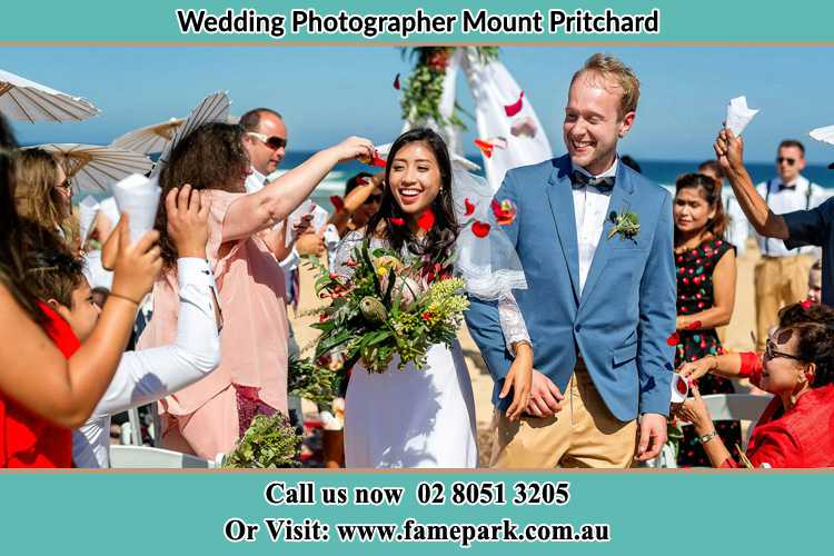 Photo of the Bride and the Groom showering flower petal by the visitors Mount Pritchard NSW 2170