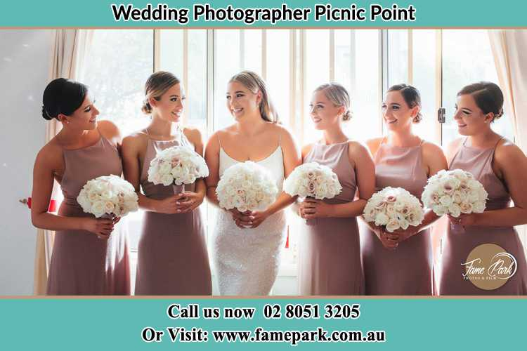 Photo of the Bride and the bridesmaids holding flower bouquet Picnic Point NSW 2213