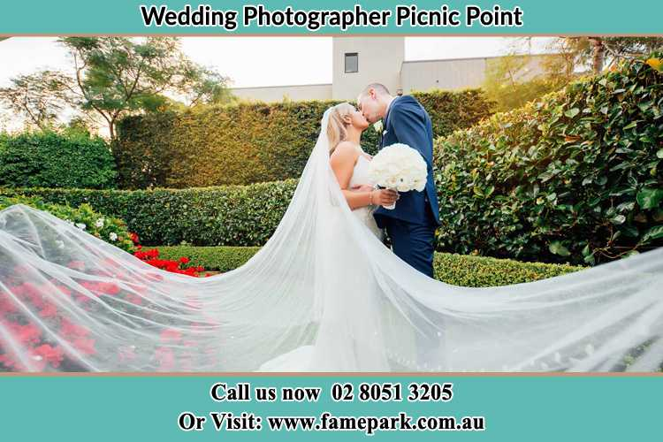 Photo of the Bride and the Groom kissing at the garden Picnic Point NSW 2213