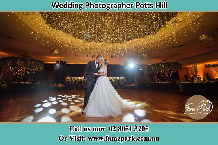 Photo of the Bride and the Groom kissing on the dance floor Potts Hill NSW 2143
