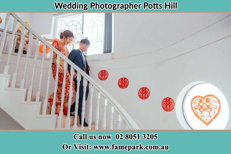 Photo of the Bride and the Groom going down the stair Potts Hill NSW 2143