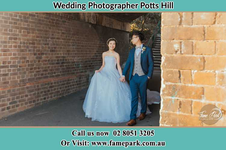 Photo of the Bride and the Groom walking Potts Hill NSW 2143