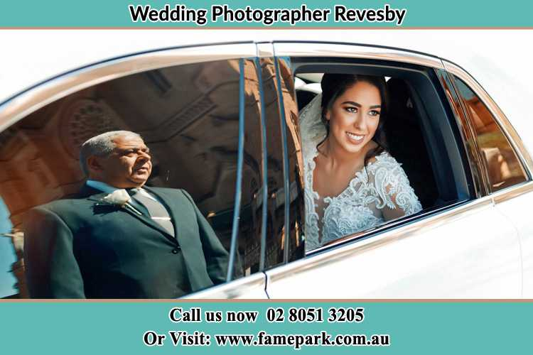Photo of the Bride inside the bridal car with her father standing outside Revesby NSW 2212