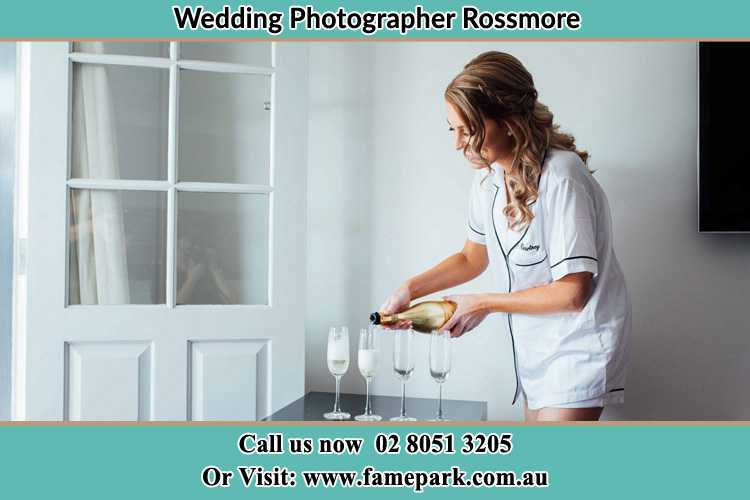 Photo of the Bride pouring wine to the glasses Rossmore NSW 2557