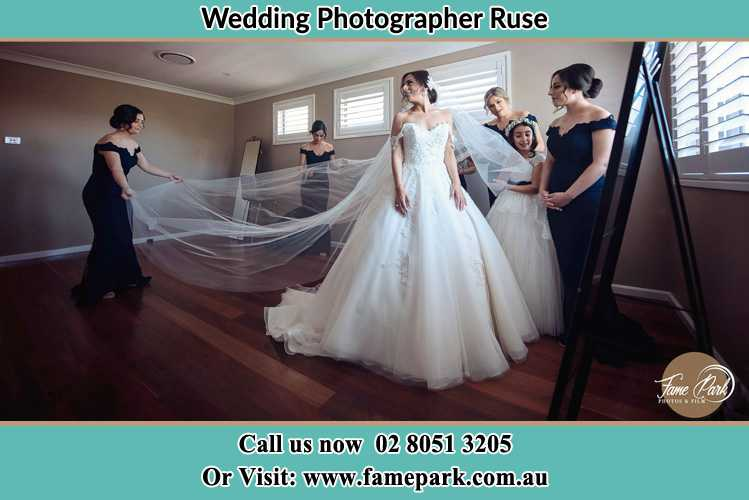 Photo of the Bride and the secondary sponsor preparing Ruse NSW 2560